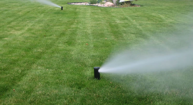 Photo Showing Water Being Blown Out Of Clients Irrigation system.
